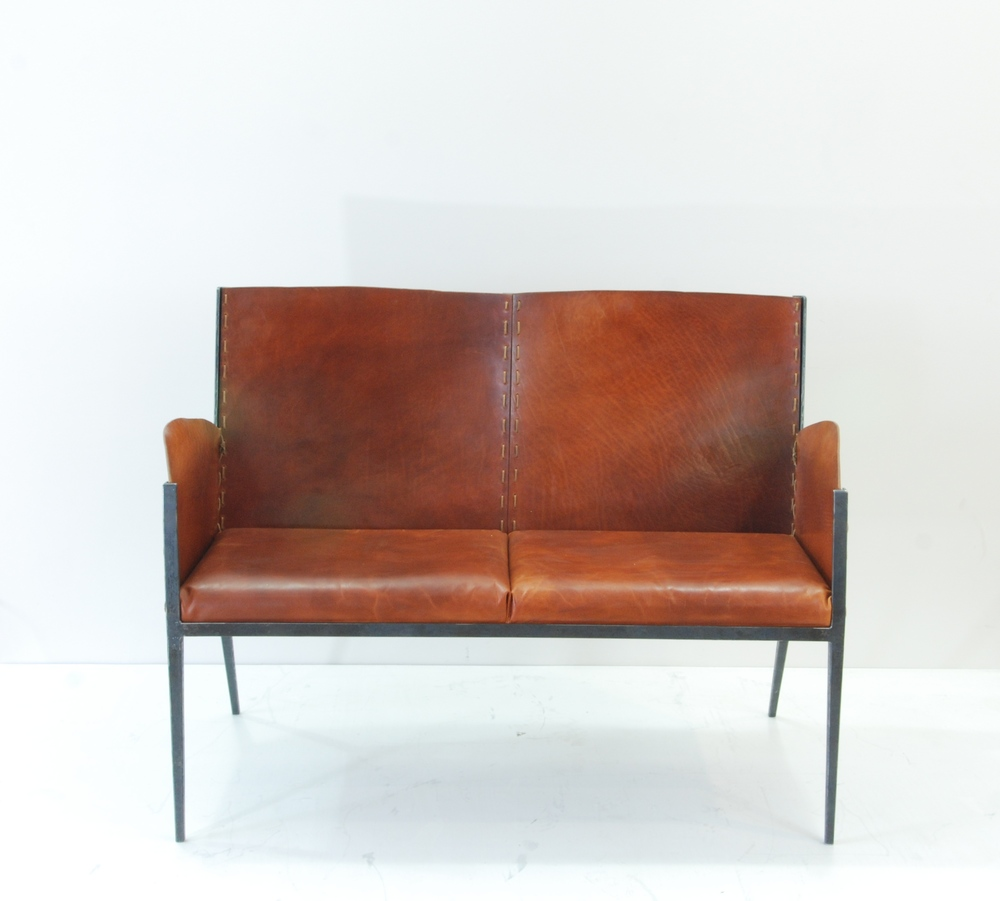 Forged steel Settee with hand cut and dyed leather