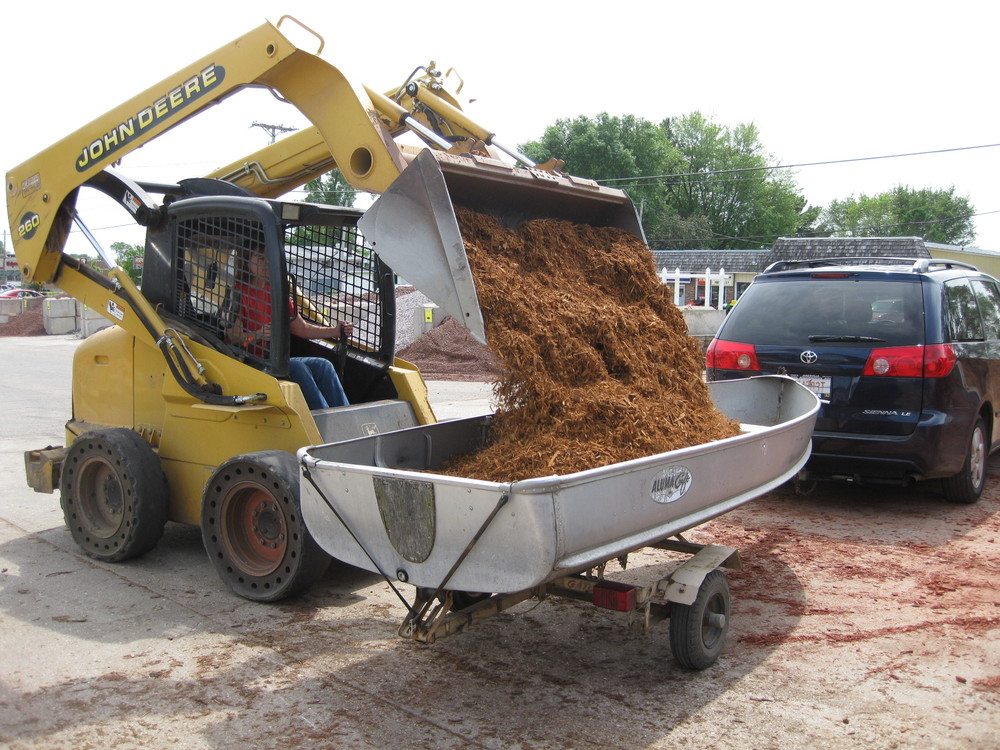 A: We use a John Deere Skid Loader with a John Deere half yard rated  bucket. We can load any open bed truck or trailer. Unfortunately, we are  unable to load ... - Services — Dvorak Landscape Supply, LLC