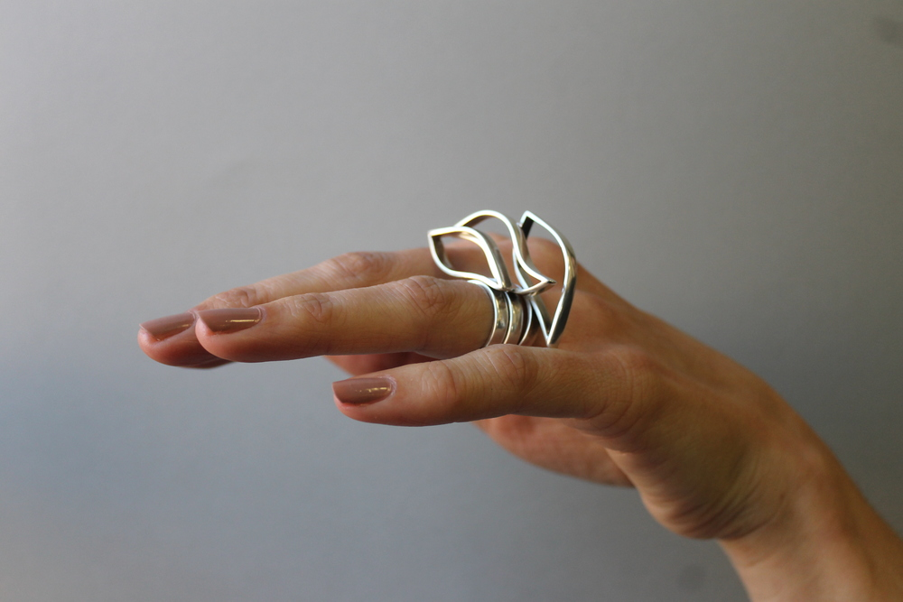 Trio of wave-shaped sterling silver rings