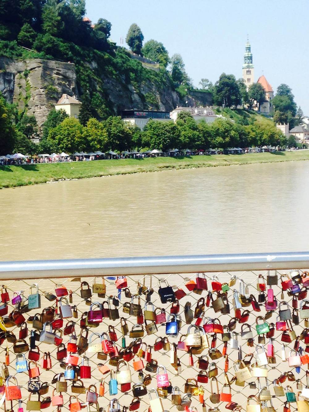 Lovers' padlocks hang from a Salzburg bridge