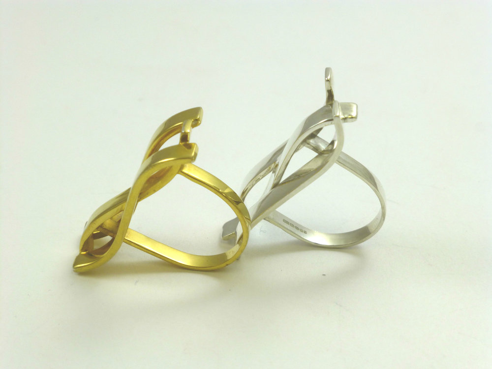 Gold and sterling silver trio wave rings