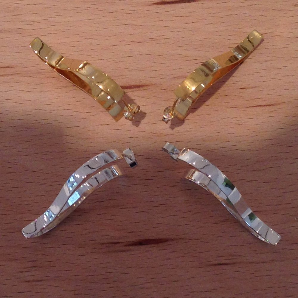 Silver and gold wave-shaped earrings