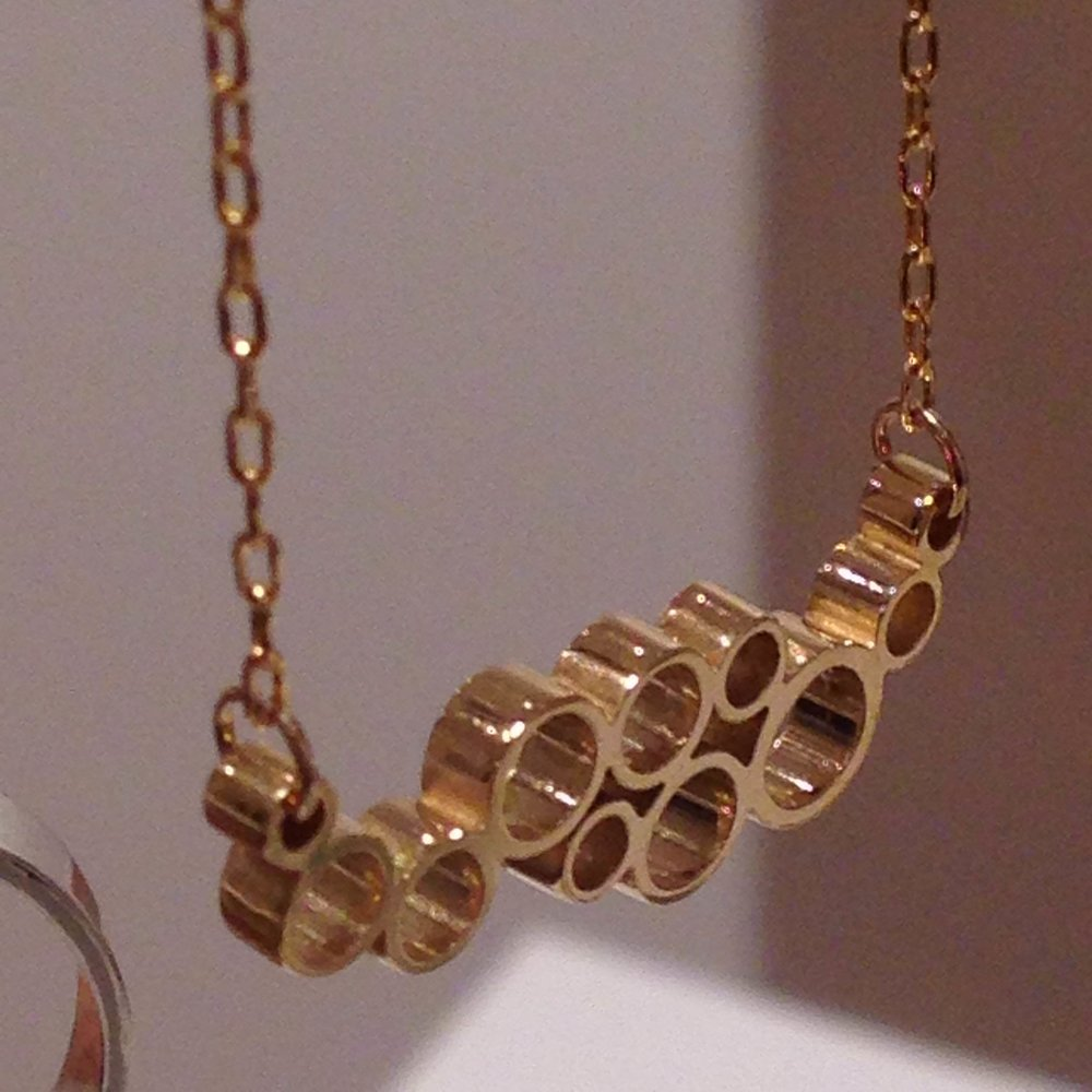Gold pendant, from the Fizz range