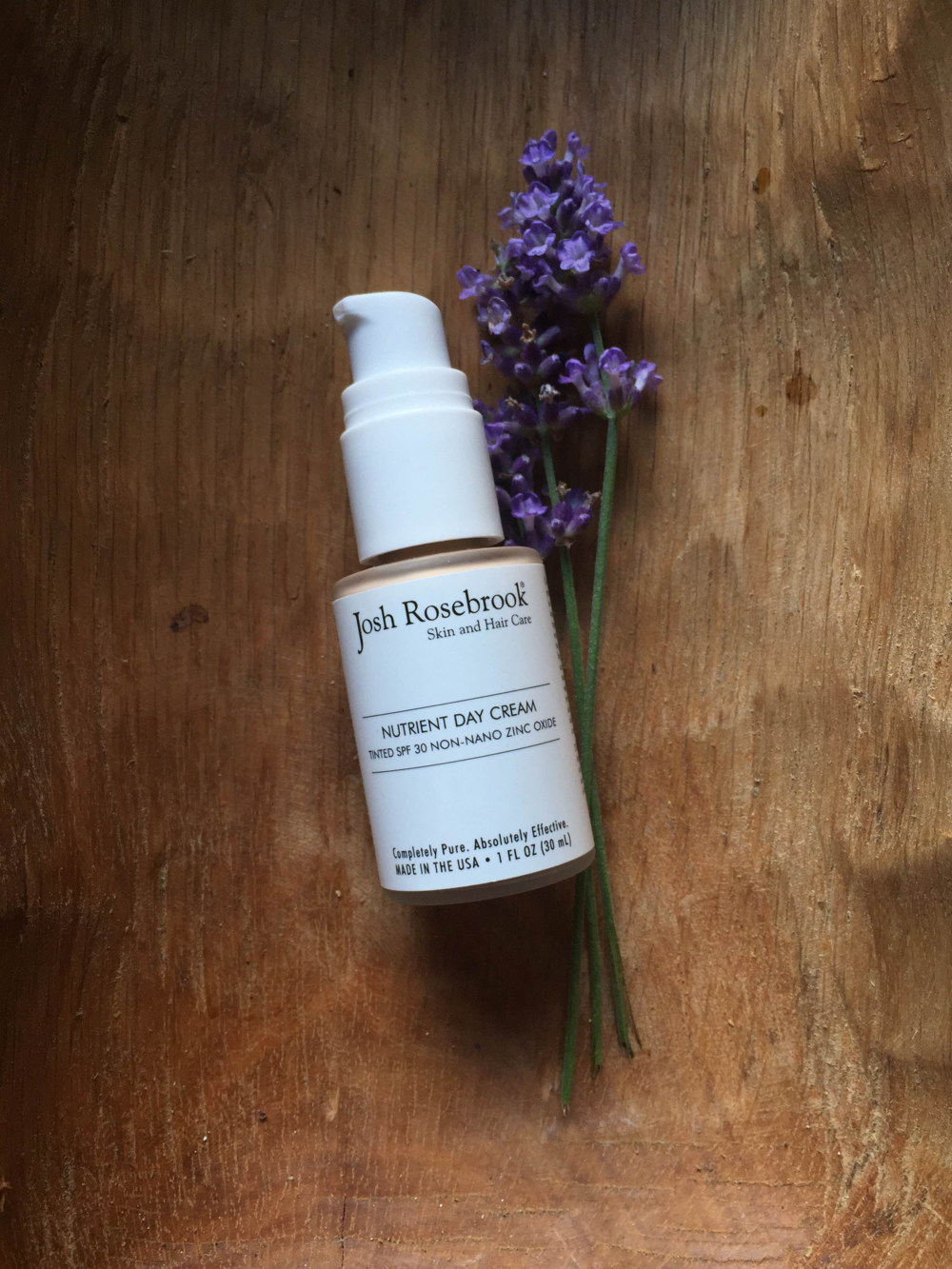 Josh Rosebrook's Nutrient Day Cream Tinted with SPF 30 Non-Nano Zinc Oxide is housed in a 1 fl. oz. (30 ml) frosted glass bottle with a pump. The plastic cap that comes with the product is not pictured in this photo. The Nutrient Day Cream Tinted with SPF 30 retails for $55.