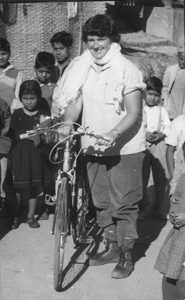 A young Dervla with bike