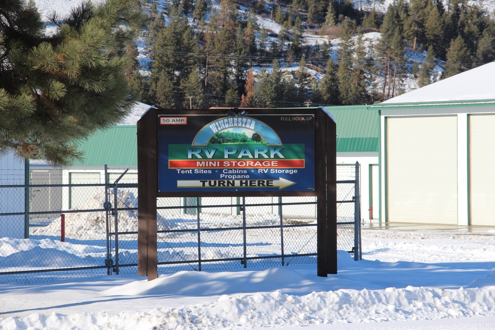 Park entrance sign & storage units.