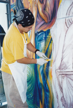 "-Tim working on fresco mural ""Santuario"" with artist Juana Alicia, San Francisco International Airport, 1999."