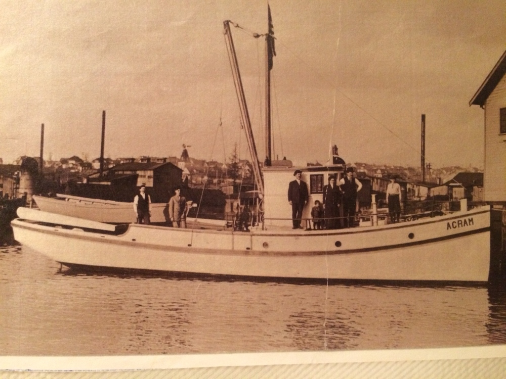 My great-grandfather's boat. My grandpa is the little one standing in front of the wheel house. My great-grandparents are standing on either side of him. This is still in Ballard. Agram is a town in Croatia; the boat was originally called Crikvenica, but everyone mispronounced the name, so he changed it.