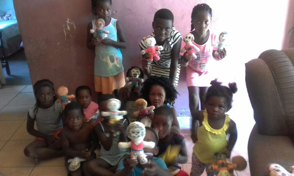 After two months, children from Gugu Dlamini Foundation based in South Africa, finally received the dolls! Gugu Dlamini works with a very vulnarable society where they run an after school program to help more than 200 black kids with home work and give them food as they come from homes where there is no food.  The children say thank you with their big smiles!