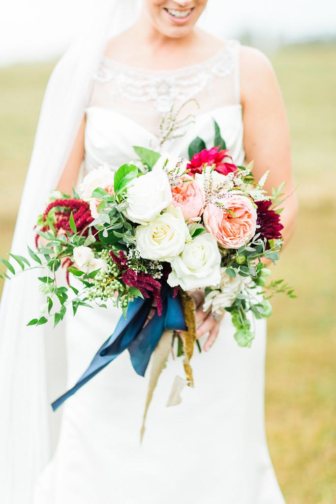 Bride-holding-Bowerbird-Florist-Bridal-Bouquet-Het-Landhuis.jpg