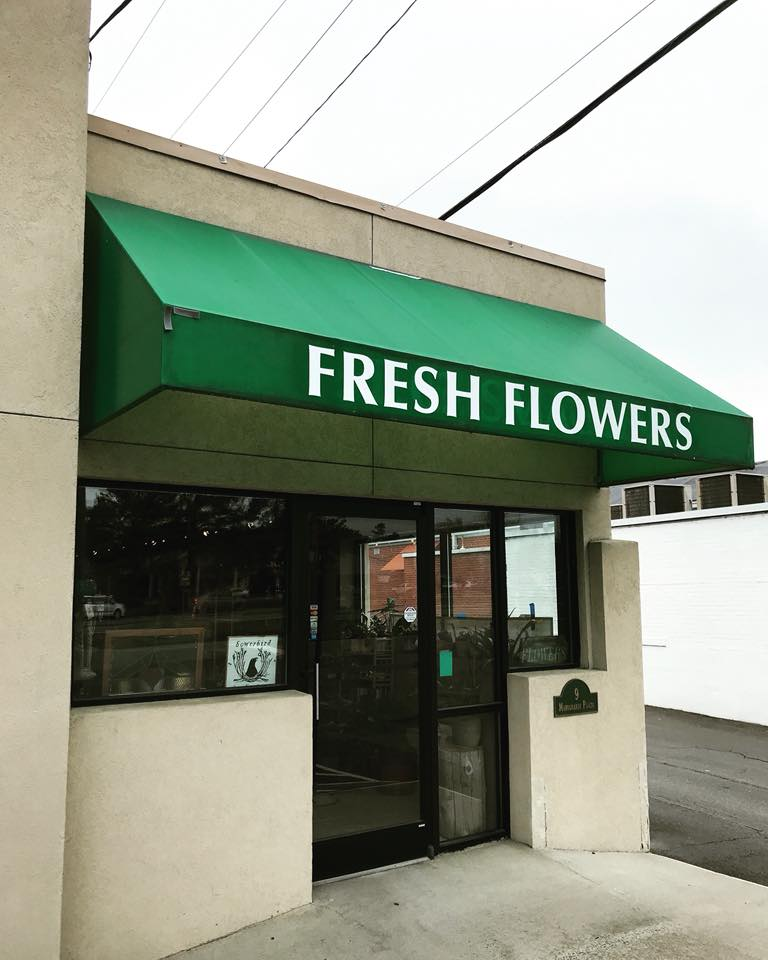 It's not hard to find us - just look for the green awning with FRESH FLOWERS lettered across it. -