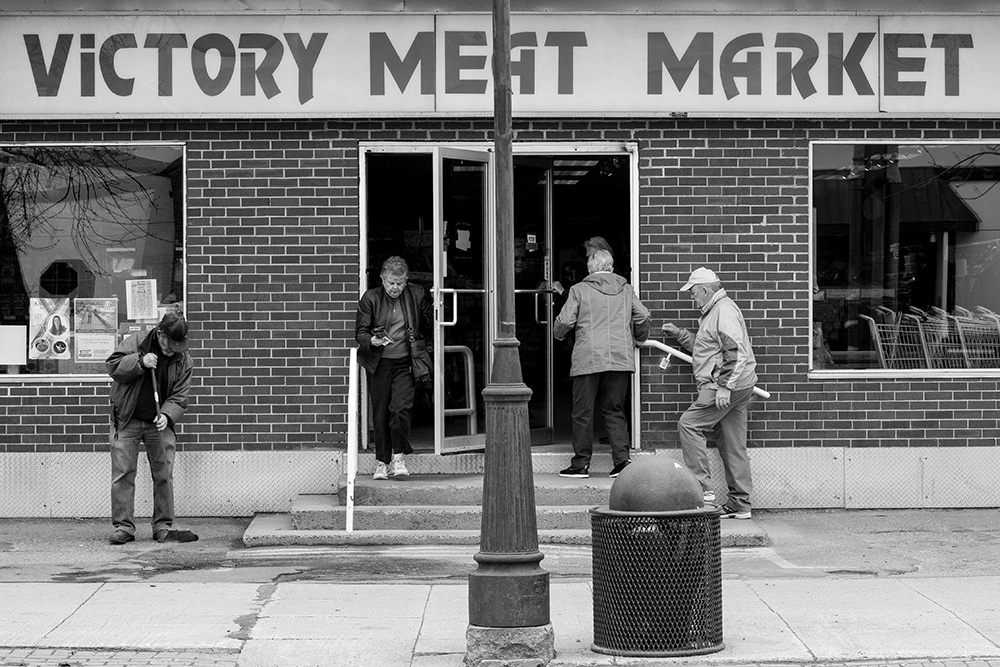 April 2016: Shoppers come and go at Victory Meat Market
