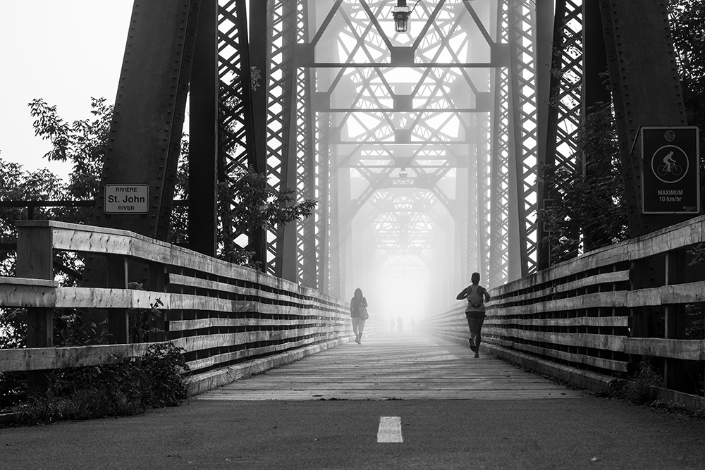 August 2015: A runner crosses the Bill Thorpe Walking bridge, shrouded in fog