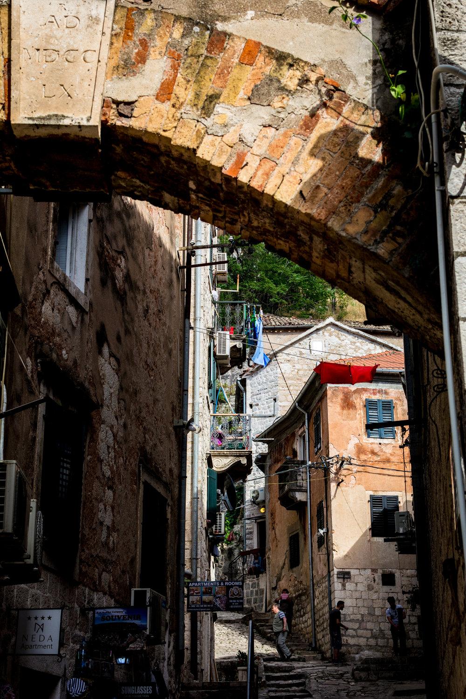 Venetian-style buildings and narrow streets in Kotor.