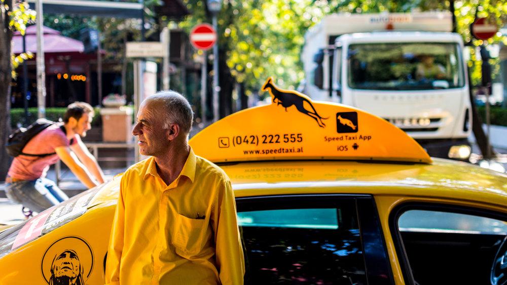 A taxi driver in Tirana, Albania.