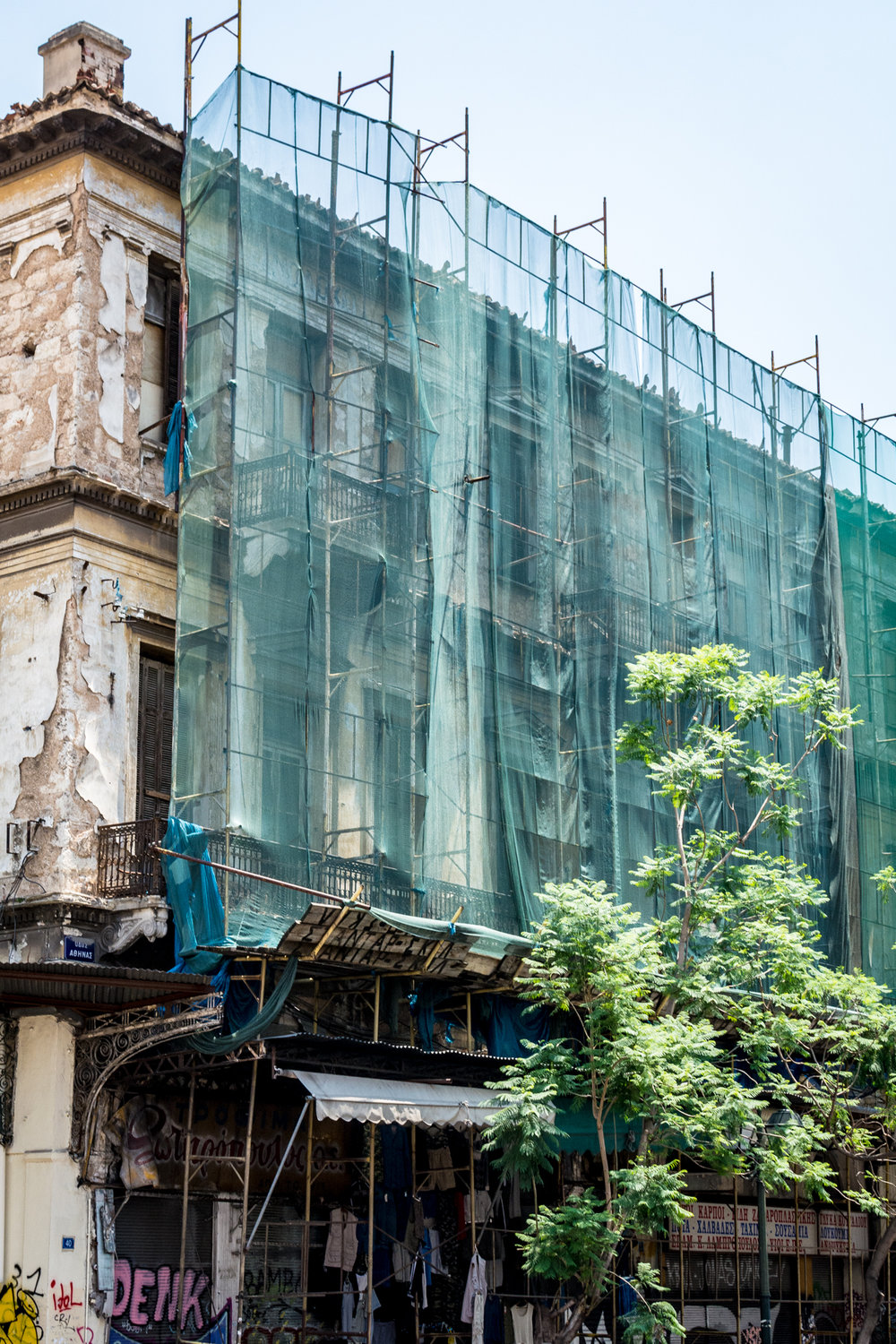 Scaffolding on building, meant to protect pedestrians from debris.