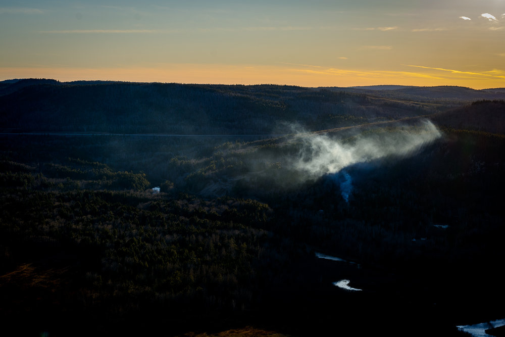 Chimney smoke catches the last light of the day in the hills of Welsford, New Brunswick.  Buy Print