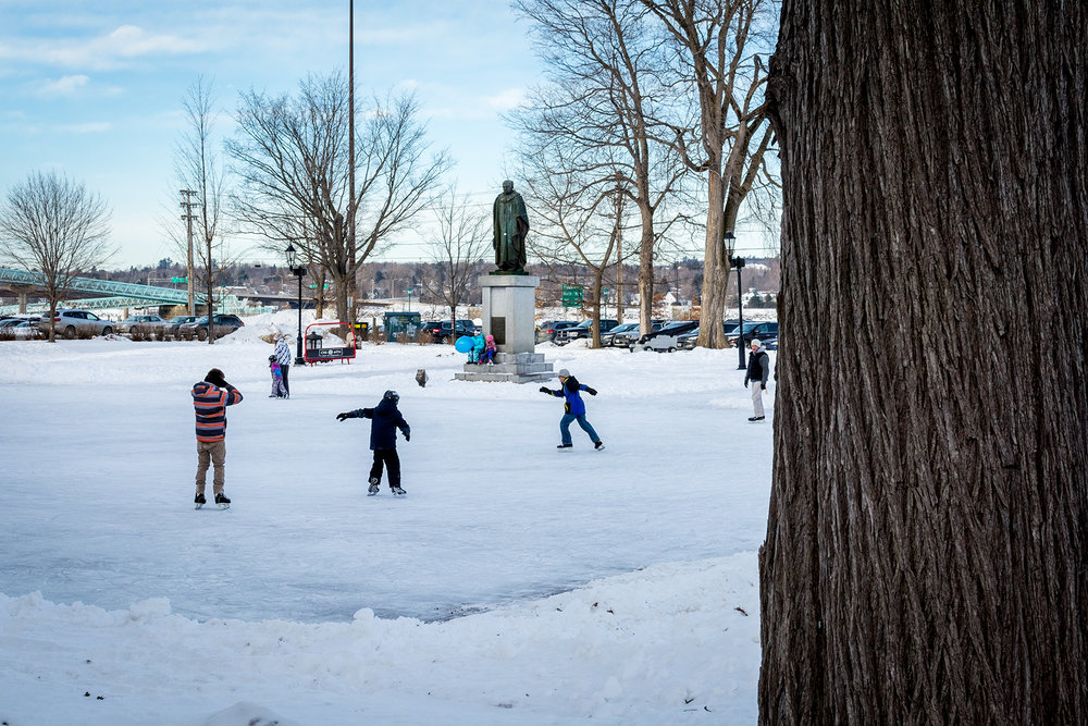 Kids skate through Officers' Square in downtown Fredericton.  Buy Print