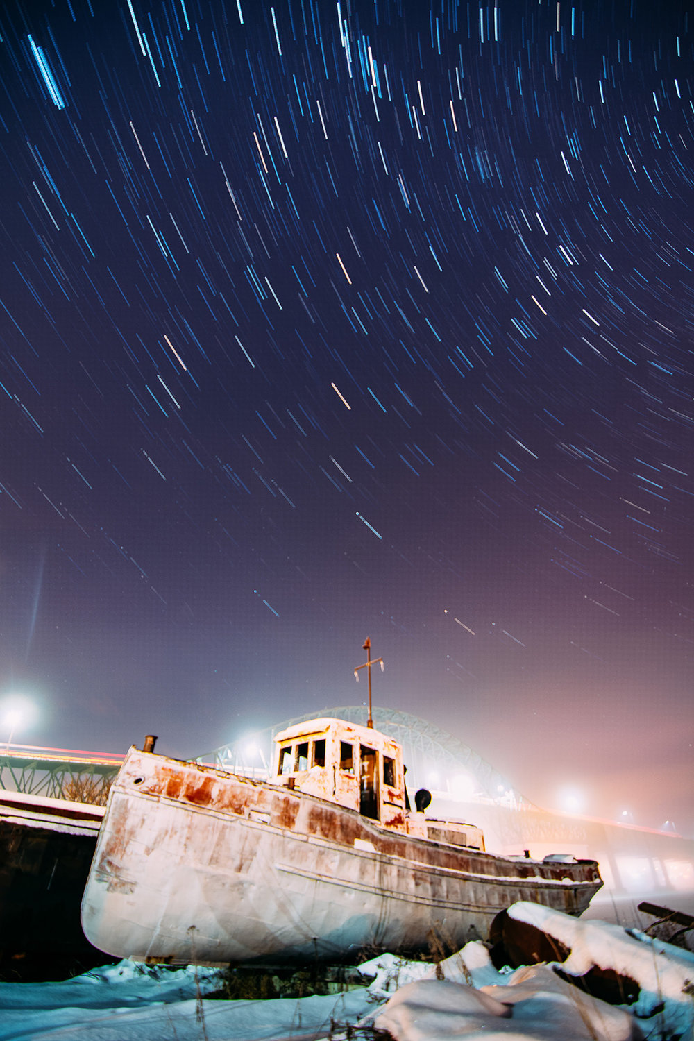 Star trails above the Centennial Bridge in Miramichi.  Buy Print