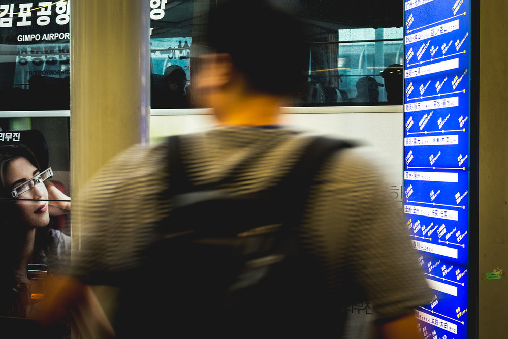 A man walks past a bus stop at Incheon International Airport.