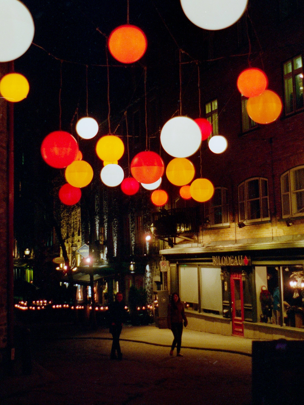 Streets of Old Quebec City lit by colourful orbs. May 2017.
