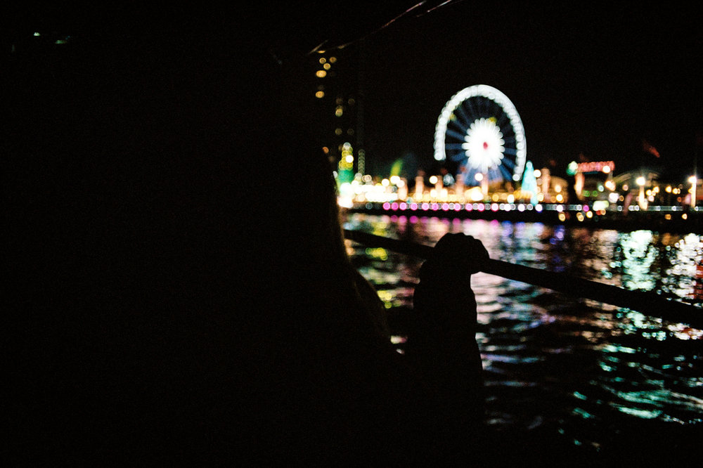 A riverboat closes in on a riverside New Year's Eve party in Bangkok.