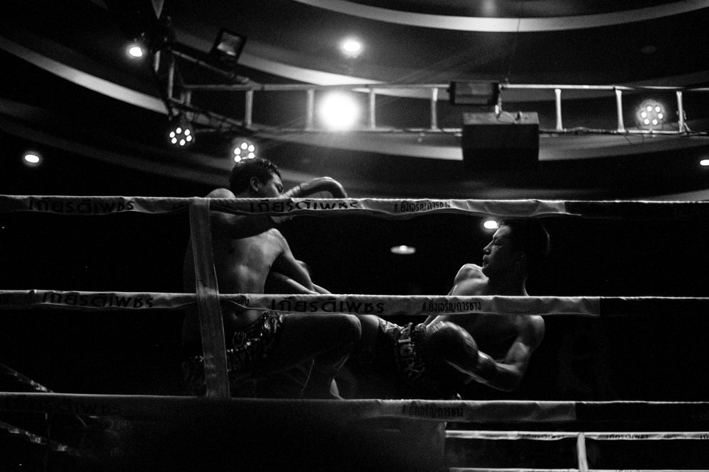 Two fighters connect at a Muay Thai match in Chiang Mai.