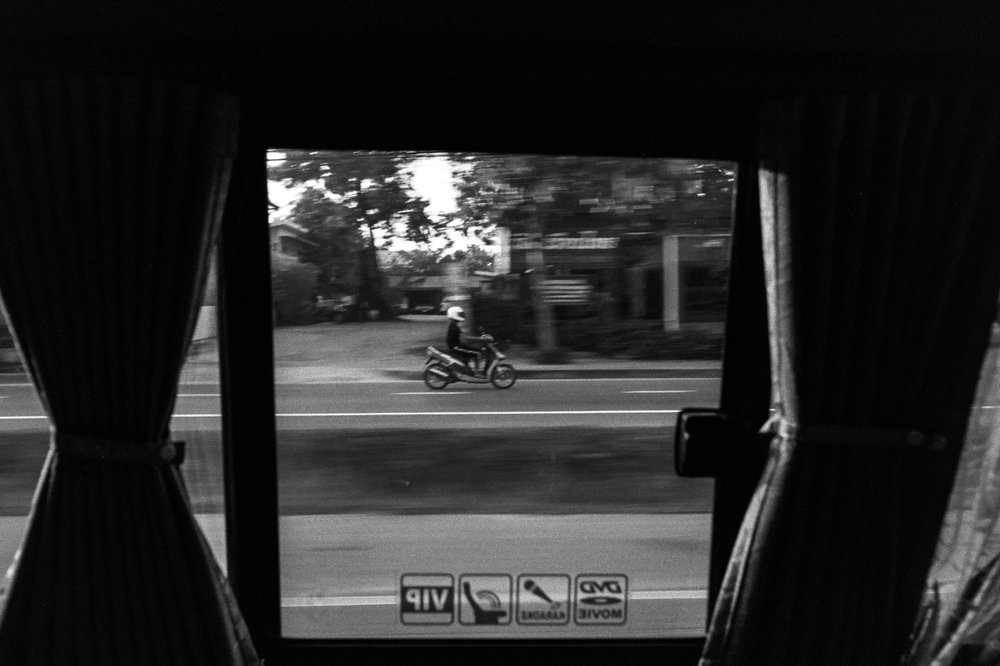 A scooter framed by the window of our van.