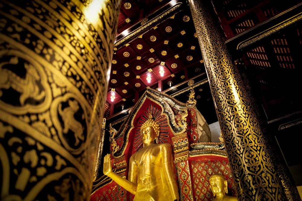 Gold details frame a golden Buddha at Wat Chedi Luang in Chiang Mai.