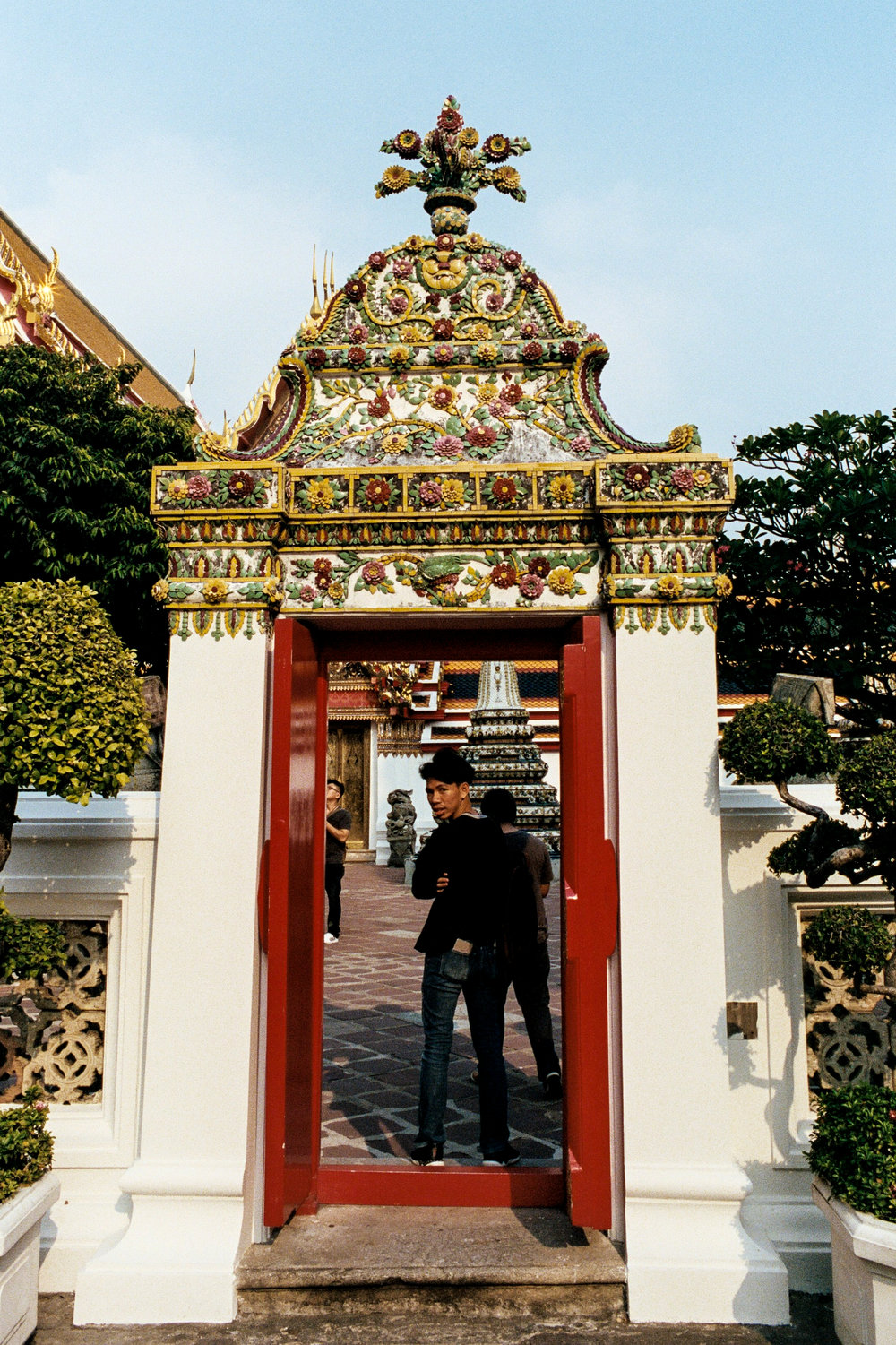 A visitor caught posing for a picture at Wat Pho. The temple is one of Bangkok's oldest.