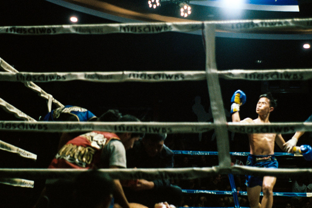 A Muay Thai fighter celebrates after a knockout win.