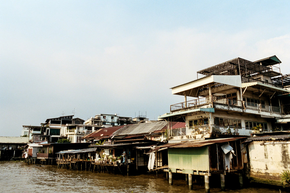 Riverside housing in Bangkok. The city has a vast network of canals, which were histrorically the main method of transportation through the city.