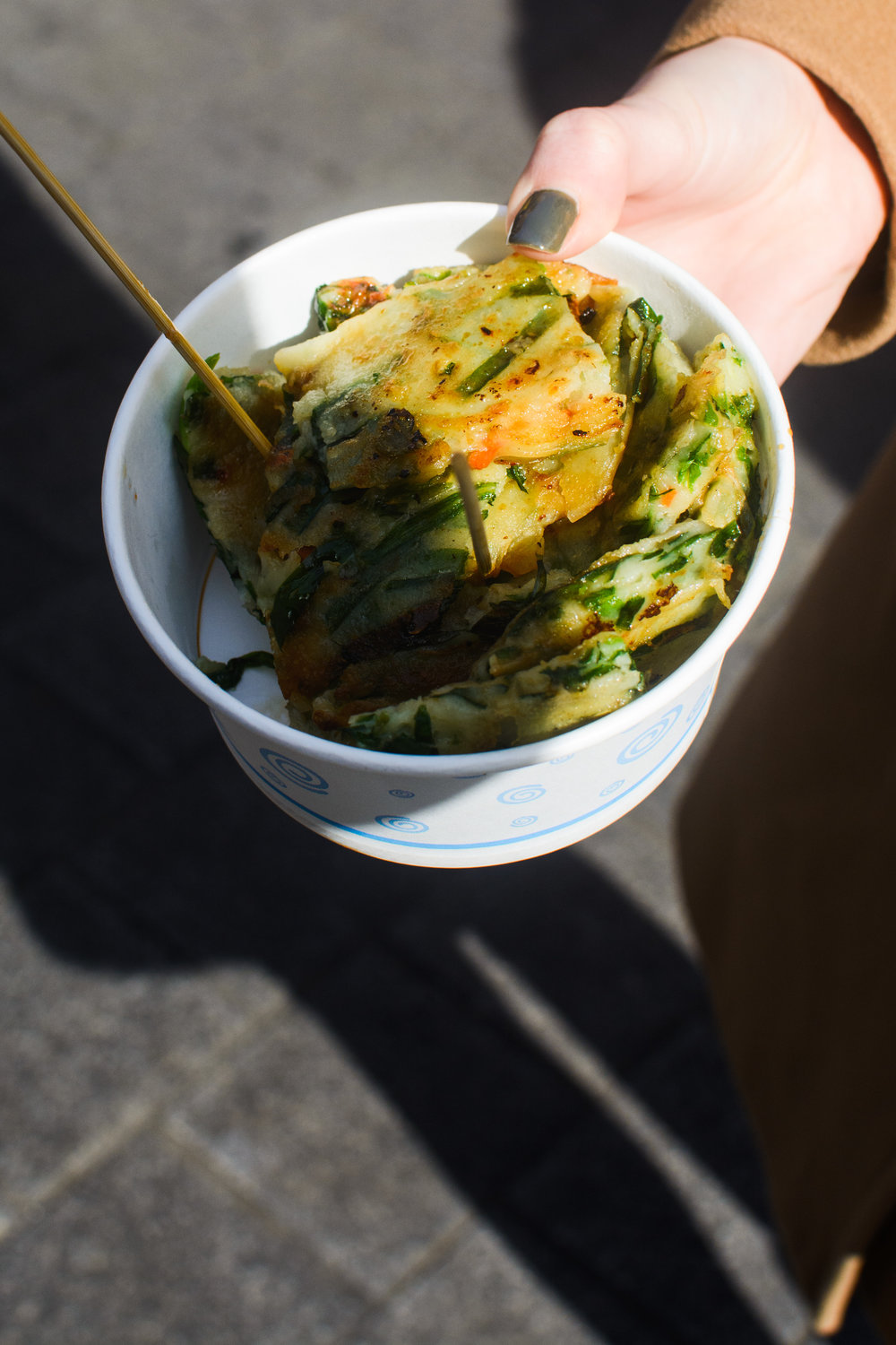 Leek pancake, cut and served in a bowl for easy street eating.