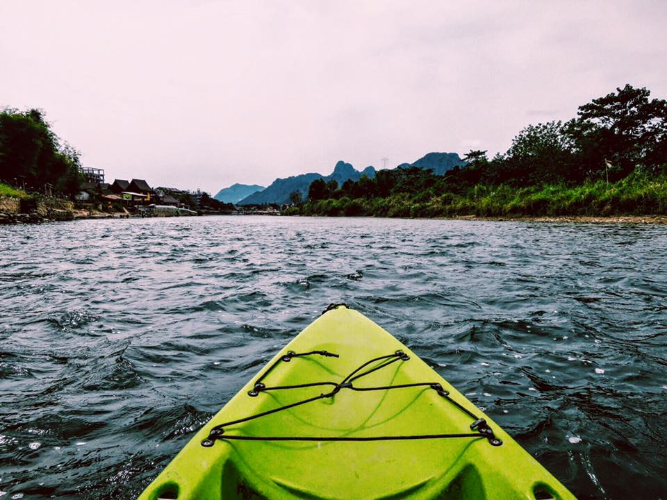 Morning glide along the Nam Song River. Mountains, rivers, & dirt cheap kayak/bicycle rentals. This is my happy place.