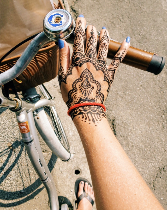 Challenge: biking with wet henna and an art print in my basket.