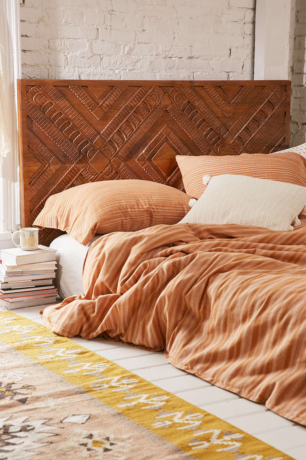 Amira Carved Wood Headboard   •  Urban Outfitters