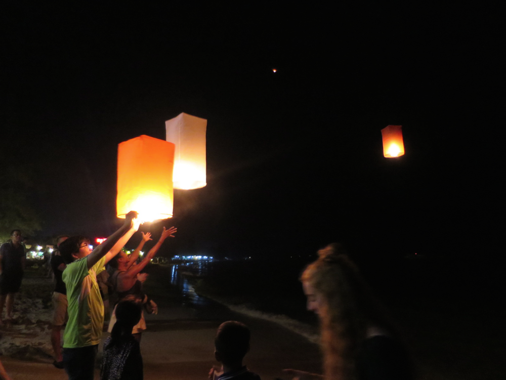 Releasing Chinese lanterns over the Gulf of Thailand.