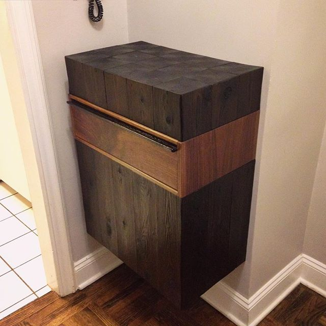 Introducing the third piece in the JAW Woodshop #firesidecollection installed in its new Manhattan home! This custom entry way piece is a wall-mounted walnut drawer box sandwiched between scorched cedar. More pics to come... #jawwoodshop #customfurniture