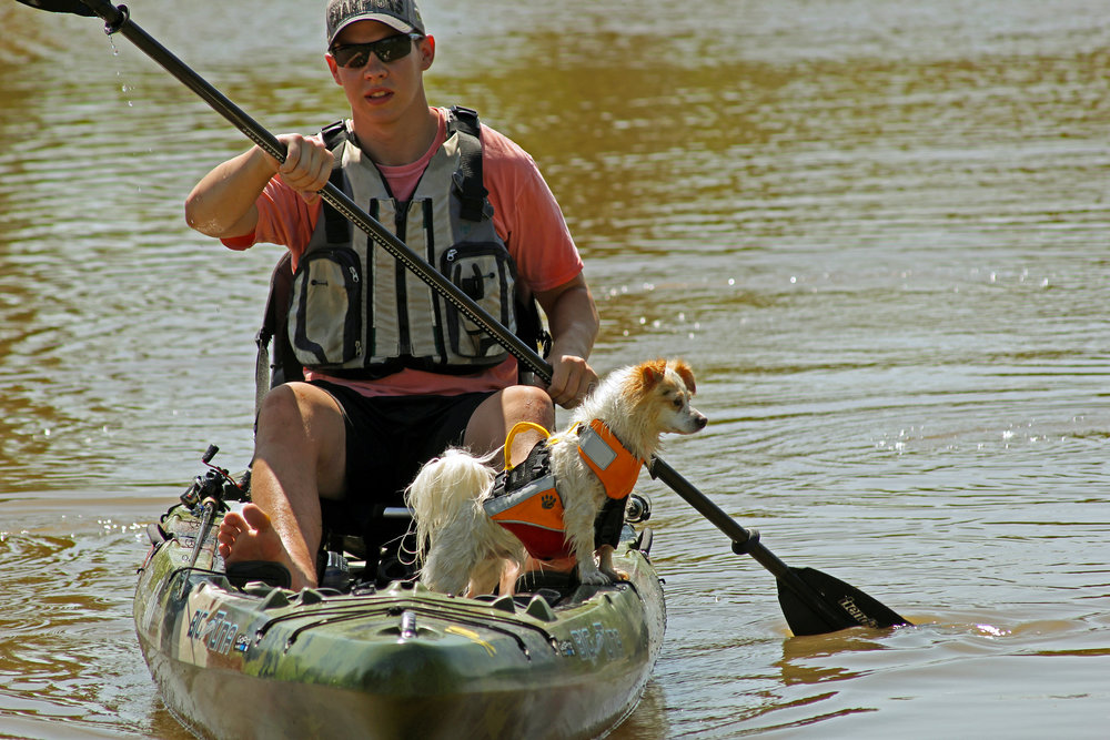 Clint Taylor with his Jackson Kayak Big Tune, Bending Branches Angler Ace and dog Pup.