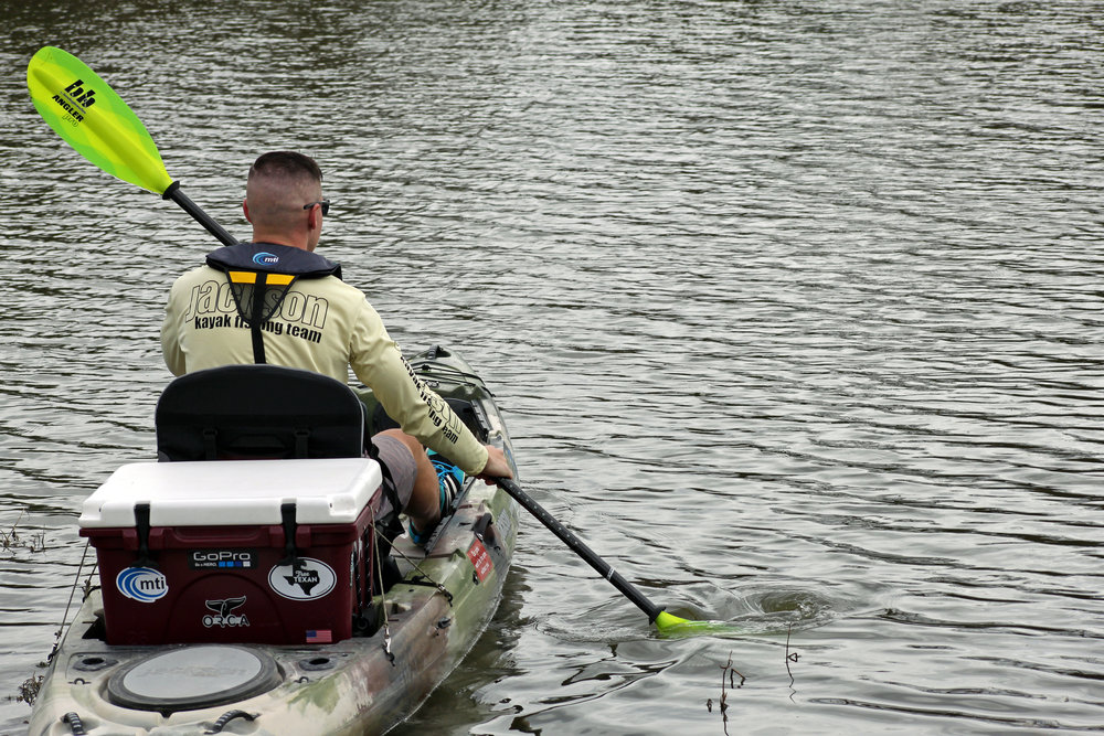 Clint Taylor paddling in a Jackson Kayak Big Tuna with his ORCA Coolers 26 qt. Cooler