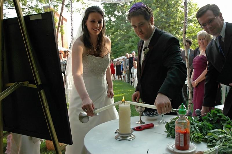 Jewish Christian Couple doing rituals at interfaith wedding