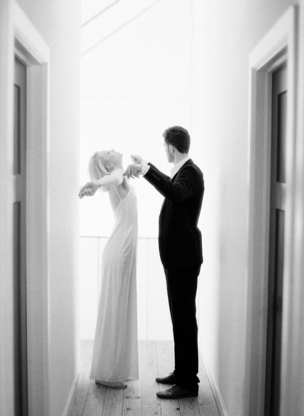 Fine Art Film Engagement Shoot in Austin TX, Quirky Couple in Hall, Black and White Film,  BW Theory