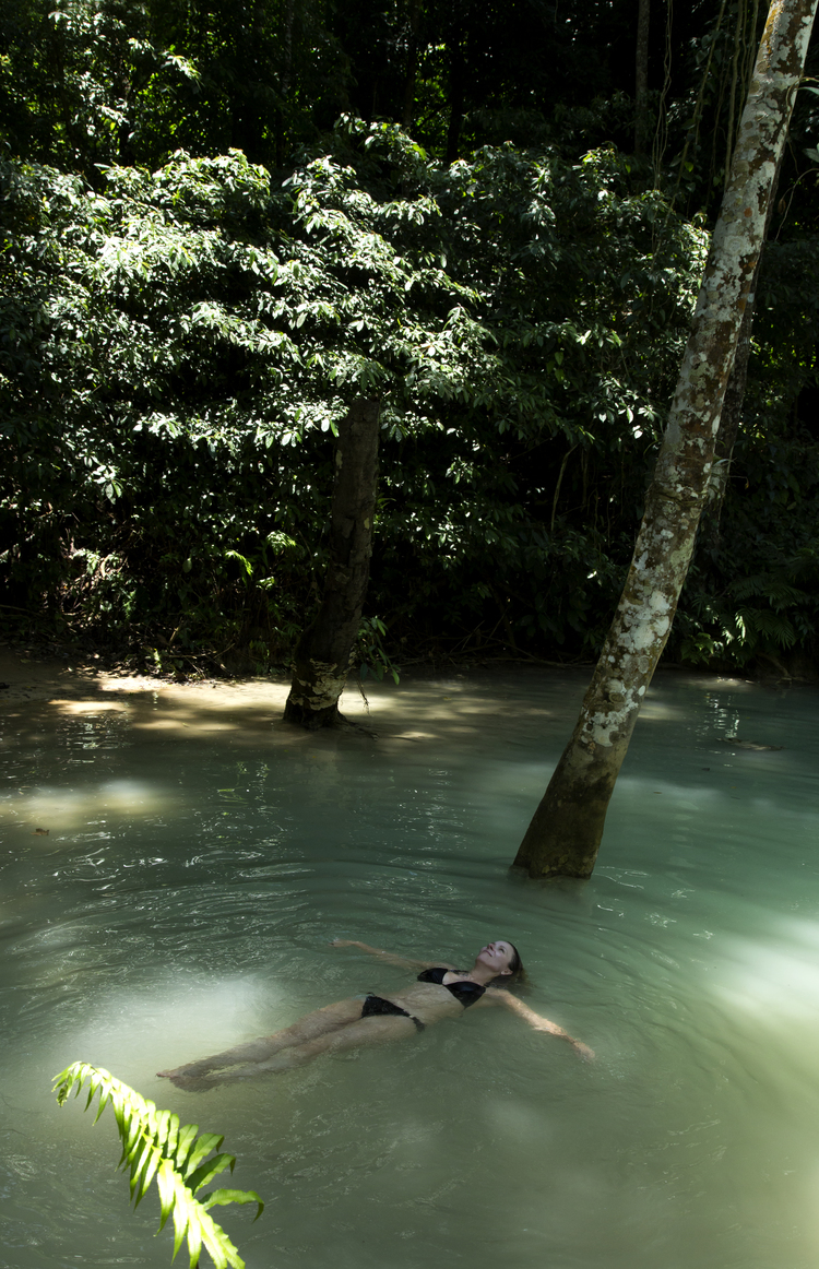 Michelle Larson - A photo I took of Julie at Kuang Si Falls in Luang Prabang, Laos. The epitome of exotic and mysterious, with its jade green milky water that flows down flat rock terraces creating tranquil pools that beg to play, float and dream in.