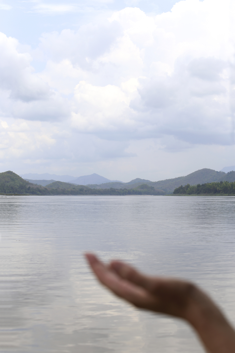 Michelle Larson  - Awe... this photo was taken by Julie. I had my hand outside the boat to touch the cool breeze and the drops of rain that were beginning to fall... feeling so SERENE and blessed to be in the moment on the Mekong River in Luang Prabang, Laos.