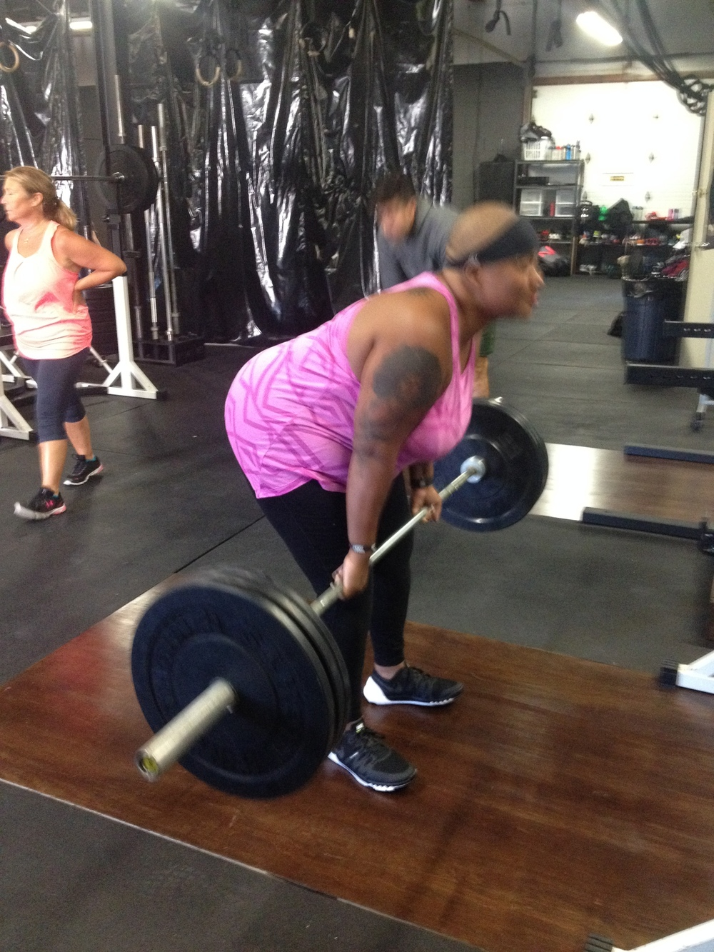Started with an empty barbell week 1. A week after this pic Tricia hit a PR (105 for 8 reps)