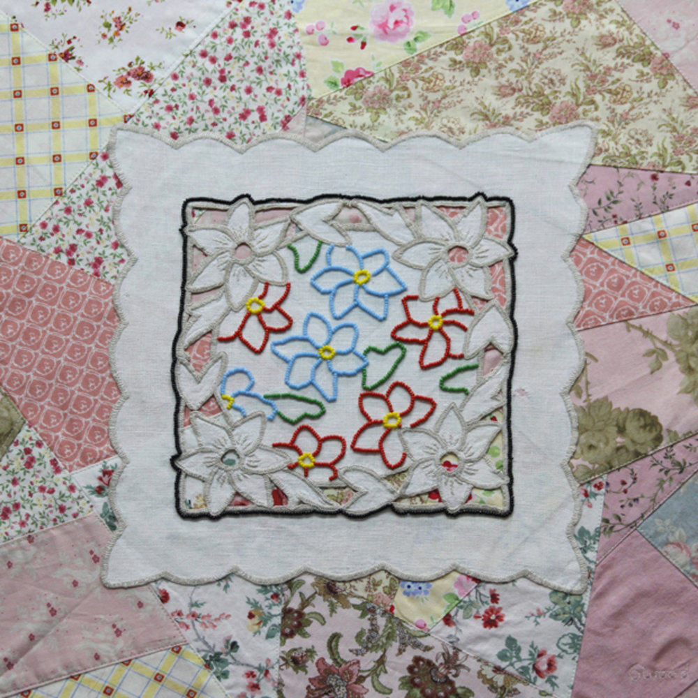 """Past and Present"". Shirley Woods. Wall hanging - Linen napkin, heritage fabric. Stitchery, quilting, and beading. 48 H x 48 W cm"
