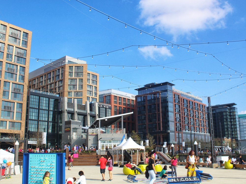 The District Wharf development features a mix of entertainment venues, restaurants, retail shops, office space, apartments, and food markets.