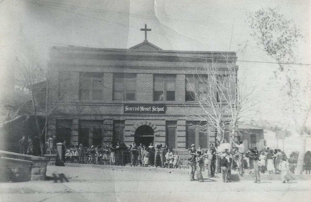Photograph of the original Sacred Heart Parochial School building (built in 1910) on the corner of Walnut St. and Arroyo Blvd. in Nogales, AZ - Photographer Unknown. Image courtesy of the Pimeria Alta Historical Society & Museum and the Nogales-Santa Cruz County Chamber of Commerce.