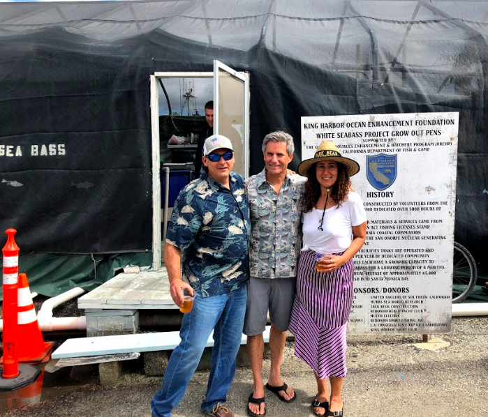 Joe Farlo, Mayor of redondo Beach and Oceans Global's Sophia neveu at the King Harbor White Sea Bass Grow out