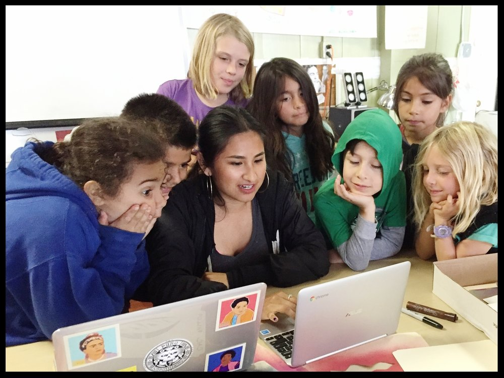 Helen DIaz Calvo shares tech skills with community youth at our 2nd annual Art & Design Summer camp.